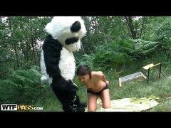 Skinny girl takes large dildo from many in bear costume