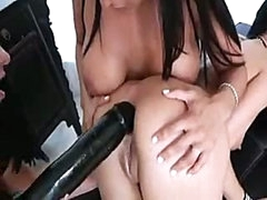 Pretty lesbian girls know how to put huge black dildo into asshole