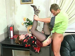 Freaky business-woman in barely dark pantyhose fucking and working at one time