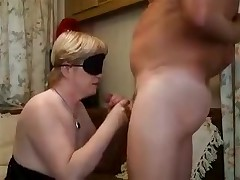 Blonde lady with a blindfold is forced to feel her way to a hard boner before putting it in her mouth. The epic blowjob gets a little too hot and she must take a break with a hand job in between the deep throats.