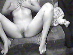 Hot black-and-white home video with busty brunette doing a blowjob on her boy-friend's pecker and riding it in reverse position.