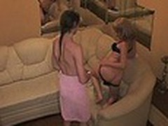 Luxurious hotel room with comfortable sofa turned into a hot fuck platform for two harlot bimbos watched by spy camera. They stripped and enjoyed the wildest rubbing action for their juicy beavers!