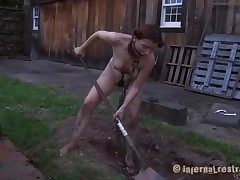 The worthless slut Maggie digs a hole to stay in it. She has a gorgeous mouth and a sexy body but she is dirty and her pretty lips spread by a bondage device. After Maggie finishes digging she needs to suck the end of the shovel and then get her shaved vagina filled with it. That's right Maggie, you know you're place