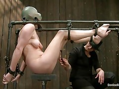Star heard about bdsm but she never thought that things could get so rough in a session of bondage sadistic masochism. She was tied on that metal frame, a rubber balloon was used to cover her head and suffocate her and then clamps were used to gape her pussy. That was only the warm up, stick around and see more