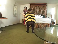 Nikki Vonn is a hot brunette babe and she is wearing a sexy pantie with high heels and fishnet dress. Now there is this midget guy in a costume of a honey bee. And horny babe Nikki doesn't mind to be his flower! See how she is sucking midget bee's stinger of love and taking all the honey out of it!