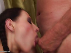 Someone must have told her that older men fuck better than younger guys as she takes not one not two rather three cocks simultaneously. She is naked for all intents and purposes as she rides a cock in reverse cowgirl and is trying to please two more cocks at the same time as she takes one in mouth.