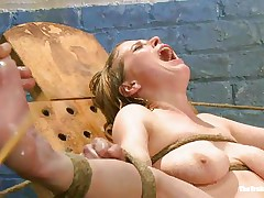 Her moaning and screaming won't help this bitch to much. The executor wants to make her pussy wet even if it means to spank and use water jets on it. She is tied with her sexy legs spread and her pink, shaved vagina is at fully display. Perhaps she will squirt if the man keeps it up that way