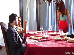 At dinning table husband tells some truth about himself, redhead wife doesn't like it and wants to leave that place. As she is going to leave she is caught by another sexy blonde babe, husband tells her to teach her wife a lesson. She lay her on the sofa and fingers her pussy and kisses her erotically. Blonde babe unzips her husband pant and pulls of his hard dick and starts sucking it in front of her husband while she is held tight by another man.