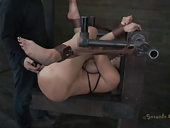 Kelly Divine is tied up with her ass up like a whore. The executor is eager to stick his dick in her but first he wants to be sure that Kelly is all wet and ready for cock. He fingers her so mean that she makes herself soaking wet and then he begins drilling her. Do you think he will cum in her pussy?