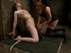 This is hot and only gets better, a dominating milf wearing stockings and sexy clothes is showing a younger cutie who's the boss. She ties her with rope and as the rope goes through those her pussy lips, a weight at the end of the rope makes things more interesting. The chick is suffocated too and probably she enjoys it a lot!