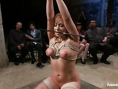 Lea is on her knees, tied up and fucked in the mouth. The public is watching her with attention and surely they will applaud her, she is giving her best to make the show interesting and that guy inserts his big hard cock deep in her mouth, making her gag a bit. Look at her, will she receive a big load?