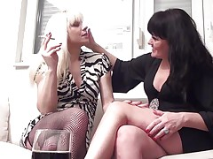 A blonde and a sexy brunette hair sits on the sofa and they talk and flirt each other. They begins to touch their bodies and kissing very intensive with the tongue. The strumpets begins to take off their dresses and now I can not wait to watch the great sex act they will surely make.