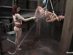 That cutie needs an intense washing and some spanking too and this mistress knows how to do the job right! She hanged her and washed her fit sexy body until she putted down, tied her with another rope and secured her in a perfect position. Are you thinking for what is that dildo in the wall?