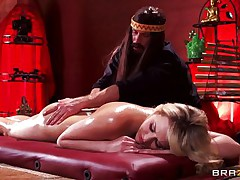 Mia is tensed and she needs a nice, oily massage. This hot blonde babe stays laid on her back, completely naked as Bill takes care of her superb body. He slides his hands on her perfect ass, massaging it firmly and then rubs her shaved pussy. Mia gets excited and now wants to fuck!