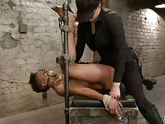 With her feet tied up and metal clamps all over her body the ebon slut endures a harsh punishment. This bitch goddess knows what he's doing and gives her both ache and pleasure. She can't even scream as her mouth is folded with scotch tape. Look at that shaved wet crack and how unfathomable she's rubbing it with the vibrator.