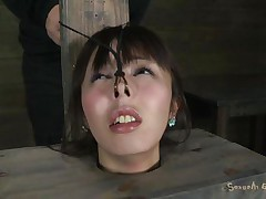 Fucking whore Marica with pretty face is all tied up in a box and has a vibrator on her tight pussy. She moans with pleasure, pleasing her horny master Matt who makes her throat suck his big hard cock. He sticks it in her dirty mouth and stays there, making her pussy so wet and wishing for more!