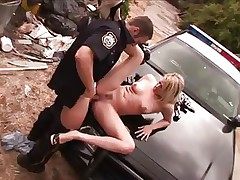 Mr. police officer does his job with rigorous attention. He takes of this blonde short pants and starts licking her sexy thighs and then her juicy vagina, using all his tongue as he does that. The blonde delinquent receives a hard fingering as a treatment and then he takes out his big hard cock and stuffs her muffin with it. She loves it and her nice titties, long sexy legs and slutty face will surely make him cum.