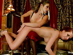 An older slut punishes her playgirl by wazoo slapping her and fingering that shaved pussy deeply. This babe holds her on her knees and dominates that sexy butt. After finishing she tied the redhead on a wooden structure, squeezed her boobs with rope and for now on is for you to find out alone what will happen to this beauty
