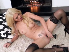 Alexis Ford takes darksome toy by the fireplace